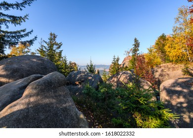 Amazing view into the landscape with rocks and colorful trees in Broumovske steny, Adrspach rocks, Czech republic - Shutterstock ID 1618022332