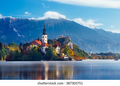 Amazing view of Julian Alpsa and lake Bled with St. Marys Church of the Assumption on the small island; Bled, Slovenia, Europe.