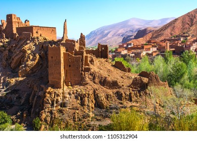 Amazing view of a Kasbah's ruin on the way to Kasbah Ait Ben Haddou near Ouarzazate in the Atlas Mountains of Morocco. Artistic picture. Beauty world.
