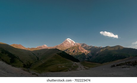 Amazing view of Kazbek mount on a sunrise panoramic view