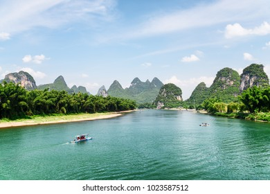 Amazing view of the Li River (Lijiang River) with azure water at Yangshuo County of Guilin, China. Beautiful karst mountains are visible on blue sky background on summer sunny day. Wonderful landscape