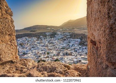 Amazing view of Lindos village, Rhodes island, Dodecanese, Greece. Sunset panorama inside the Castle. One of the most famous tourist destination in South Europe.