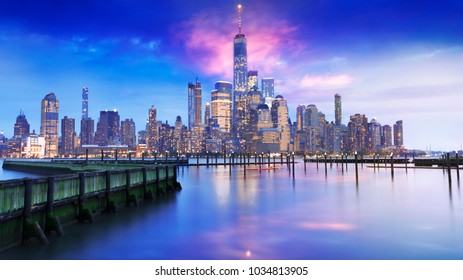amazing view of lower Manhattan , financial district with sunset