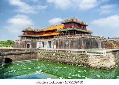 Amazing view of the Meridian Gate and a moat surrounding the Imperial City with the Purple Forbidden City within the Citadel in Hue, Vietnam. Hue is a popular tourist destination of Asia.