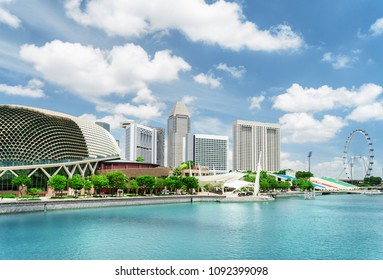 Amazing view of modern buildings and Marina Bay with azure water in Singapore. Scenic sunny summer cityscape. Singapore is a popular tourist destination of Asia.