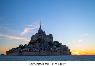 Amazing view of Mont Saint-Michel castle at sunset time. Normandy, northern France