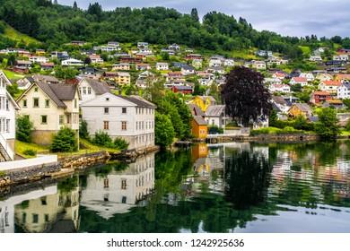 Amazing view of Norheimsund near Steinsdalsfossen. Location: Norheimsund, Hardangerfjord, Norway.  Artistic picture. Beauty world.
