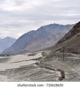 An amazing view of the Nubra Valley on a cloudy morning, softening up the landscape, and providing layers in the mountain ranges.