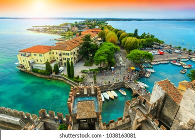 Amazing view to the old bridge and harbor of Sirmione, from the Scaliger castle with lake Garda in background, Lombardy region, Italy, Europe