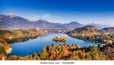 Amazing view on Bled Lake, Island, Church And Castle with mountain range in the background. Top view Bled, Slovenia, Europe