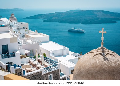 Amazing view on Mediterranean Sea and Oia, Santorini. Сruise ship stands in the bay. Travel, vacation and holidays in Europe.