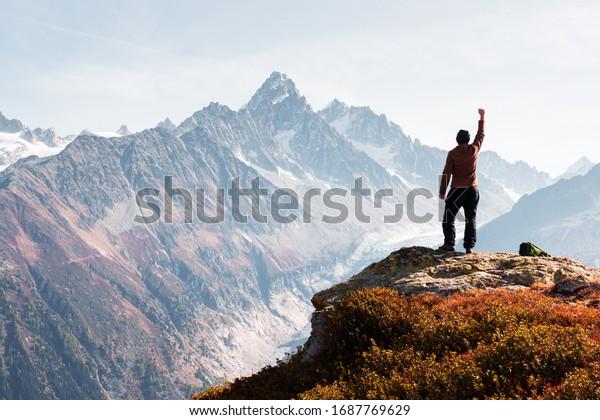 Amazing view on Monte Bianco mountains range with tourist on a foreground. Vallon de Berard Nature Preserve, Chamonix, Graian Alps. Landscape photography