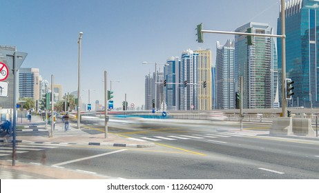 Amazing view on Sheikh Zayed road surrounded Dubai Marina and JLT skyscrapers from crossroad, Dubai. Traffic lights, tram and metro line. United Arab Emirates