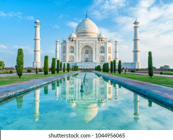 Amazing view on the Taj Mahal in sunset light with reflection in water. The Taj Mahal is an ivory-white marble mausoleum on the south bank of the Yamuna river. Agra, Uttar Pradesh, India.