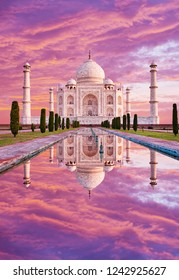 Amazing view on the Taj Mahal in sunset light with reflection in water. The Taj Mahal is an white marble mausoleum on the south bank of the Yamuna river. Agra, Uttar Pradesh, India