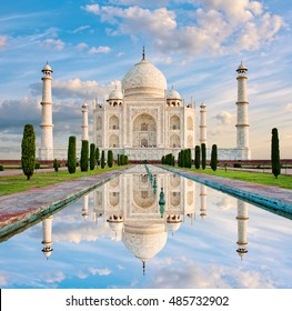 Amazing view on the Taj Mahal in dawn light with reflection in water. The Taj Mahal is an ivory-white marble mausoleum on the south bank of the Yamuna river. Agra, Uttar Pradesh, India.