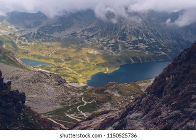 Amazing view on Valley of Five Lakes (Dolina pieciu stawów polskich) in the High Tatras, Zakopane, Poland. Landscape shot with lakes and trail up from Tatra National Park.