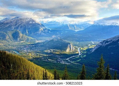 amazing view over the little town of Banff and the  Canadian Rockies seen from Sulphur Mountain . With a gondola you can  go  to the mountaintop .