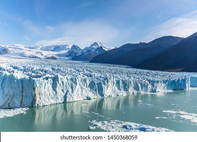 Amazing view of Perito Moreno glacier, blue ice burg glacier from peak of the mountain through the aqua blue lake in Los Glaciares National Park, Santa Cruz, Argentina, southern Patagonia ice field.