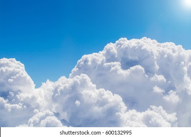 Amazing view from plane on the blue sky, empty space,cloud and sunlight
