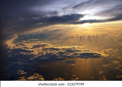 Amazing view from plane on sunrise sun and clouds