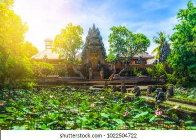 Amazing view of pond with lotus flowers near Pura Saraswati Hindu temple in Ubud, Bali, Indonesia