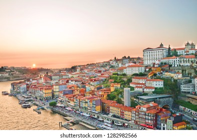 Amazing view of portuguese Porto and its city center with dominant Porto Cathedral during beautiful summer sunset. The historical old town is located along Douro river.