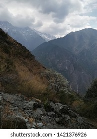 Amazing view of the rocks on the Tiger's Leaping Gorge area in Yunnan region, close to Shangri-La, seen in different timings and lights with the Yangtze River passing on the bottom.