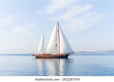 Amazing view to sailboat with white sails in the sea