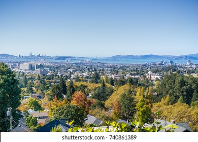 Amazing view of the San Francisco bay from a residential area in Oakland on a sunny autumn day; San Francisco and Marin Headlands in the background; California