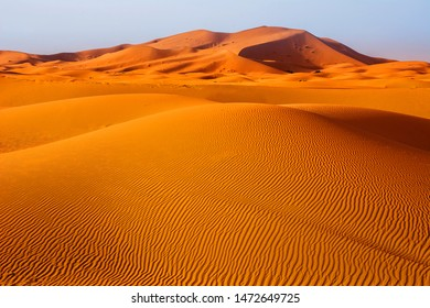 Amazing view of sand dunes in the Sahara Desert. Location: Sahara Desert, Merzouga, Morocco. Travel concept. Artistic picture. Beauty world.