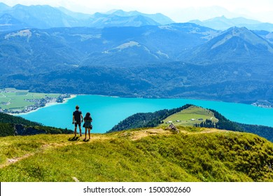 Amazing view from Schafberg by Sankt Wolfgang im Salzkammergut on lake Wolfgangsee, alps mountains, blue sky, two peaple. Upper Austria (Oberosterreich), , Salzburg