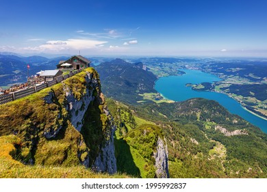 Amazing view from Schafberg by St. Sankt Wolfgang im in Salzkammergut, Haus house Schafbergspitze, lake Mondsee, Moonlake. Blue sky, alps mountains. Upper Austria, Salzburg, near Wolfgangsee, Attersee - Shutterstock ID 1995992837