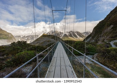 Amazing view of snowcapped mountains from a suspension bridge at Hooker Valley, Aoraki/Mount Cook National Park, South Island of New Zealand