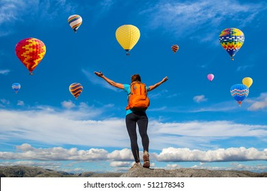 Amazing view with sport girl and a lot of hot air balloons. Artistic picture. Beauty world. The feeling of complete freedom