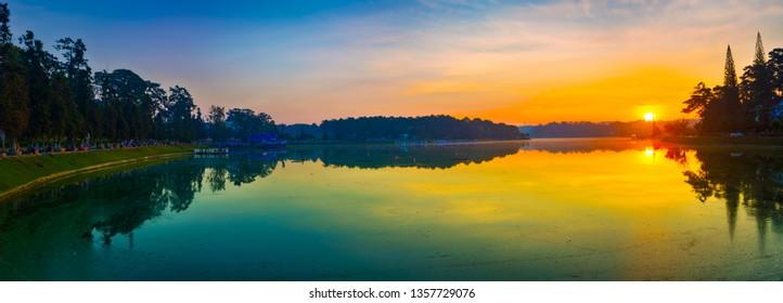 Amazing view of sunrise over Xuan Huong Lake, Dalat, Vietnam. Panorama