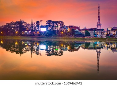 Amazing view of sunrise over Xuan Huong Lake, Dalat, Vietnam. Cityscape photo.