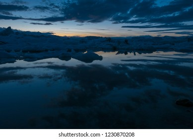 Amazing view of the sunset on Jökulsárlón glacial lake in southeast Iceland, on the edge of Vatnajökull National Park. Situated at the head of the Breiðamerkurjökull glacier.