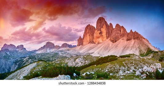 Amazing view of The Three Peaks of Lavaredo (Tre Cime di Lavaredo) at sunset. Trentino Alto Adige, Dolomites mountains, South Tyrol, Italy, Europe. UNESCO