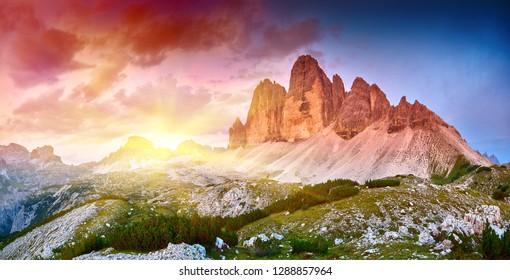Amazing view of The Three Peaks of Lavaredo (Tre Cime di Lavaredo) at sunrise. Trentino Alto Adidge, Dolomites mountains, South Tyrol, Italy, Europe. UNESCO
