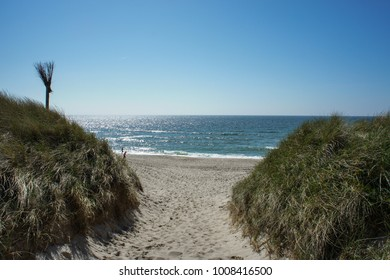 Amazing view through the dunes into the blue ocean
