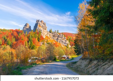Amazing view of Tustan fortress - archaeological and natural monument of national significance, popular tourist landmark - at sunny autumn day. Location place: Urych, Carpathian Mountains, Ukraine