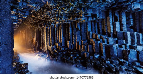 Amazing view of wall of stones cave, Fingal's cave stones type in Scotland, Beautiful cave view of gray stones out of country.