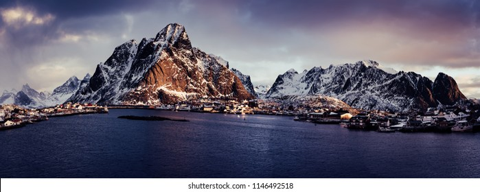 Amazing view to the winter Reine village at pink sunrise. Northern Norway, Lofoten Islands. Panorama