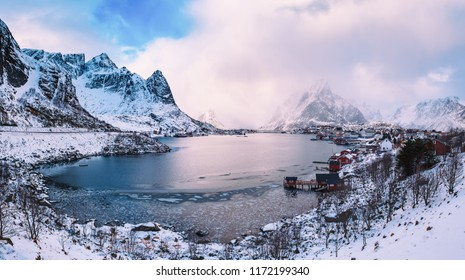 Amazing view to the winter Reine village with dramatic sky. Northern Norway, Lofoten Islands. Panorama