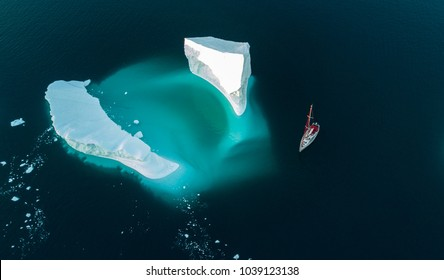 Amazing view. Yacht and iceberg. Drone view. We are so small....