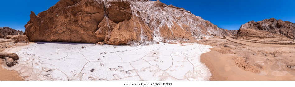 Amazing views of Death Valley at Atacama Desert, the dry water is transformed onto salt flats inside the valleys of this awe canyon in between the Atacama arid land. Amazing desert landscape