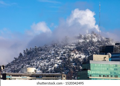 Amazing views of Santiago de Chile city during the 15th July 2017 snowfall, the biggest snowfall in Santiago de Chile history in last decades. Virgin Mary over San Cristobal Hill Santiago, Chile