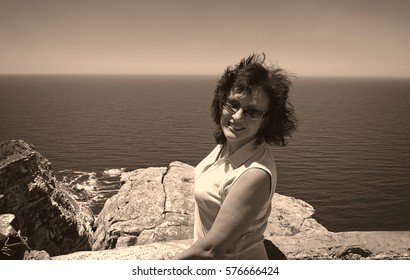 Amazing vintage of a beautiful smiling woman. Sweet memories. Classic image.Travel & Vacation. Old photo. Black white photography. Stunning retro photo. Nostalgia. Creative artwork. Nice postcard