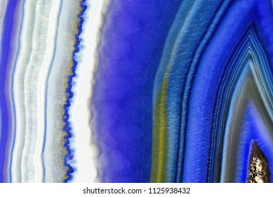 Amazing Violet Agate Crystal cross section. Natural translucent agate crystal surface, Purple abstract structure slice mineral stone macro closeup